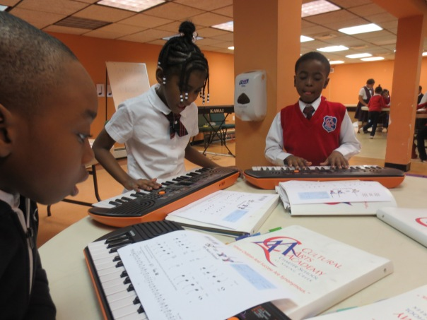 Scholars practicing musical selections in Keyboard Class.